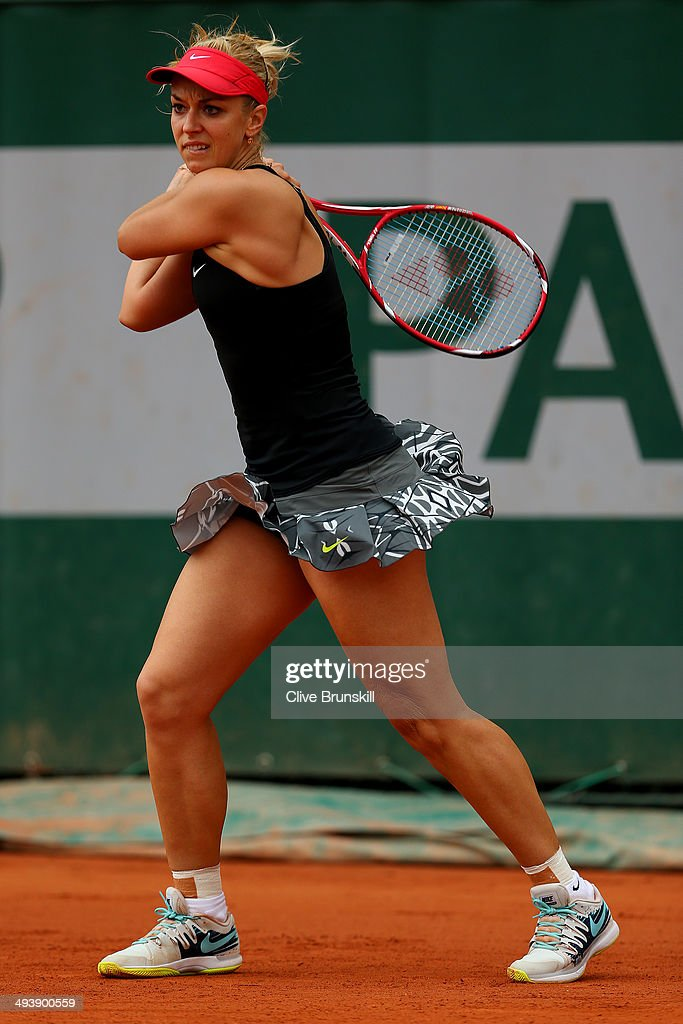 Sabine Lisicki of Germany returns a shot during her women's singles match against Fiona Ferro of France on day two of the French Open at Roland Garros on May 26, 2014 in Paris, France.