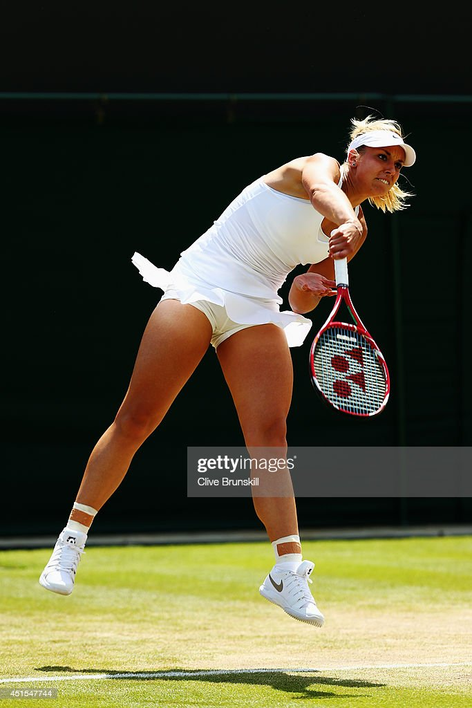 <a gi-track='captionPersonalityLinkClicked' href=/galleries/search?phrase=Sabine+Lisicki&family=editorial&specificpeople=645395 ng-click='$event.stopPropagation()'>Sabine Lisicki</a> of Germany serves during her Ladies' Singles fourth round match against Yaroslava Shvedova of Kazakhstan on day eight of the Wimbledon Lawn Tennis Championships at the All England Lawn Tennis and Croquet Club on July 1, 2014 in London, England.