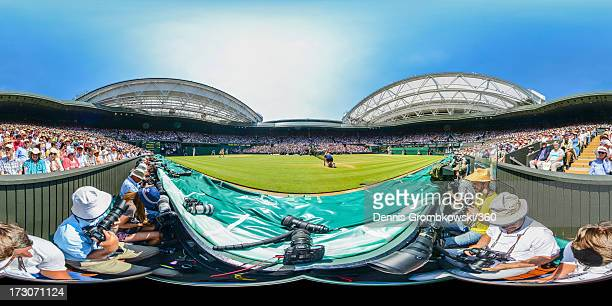 Sabine Lisicki of Germany serves during the Ladies' Singles final match against Marion Bartoli of France on day twelve of the Wimbledon Lawn Tennis...