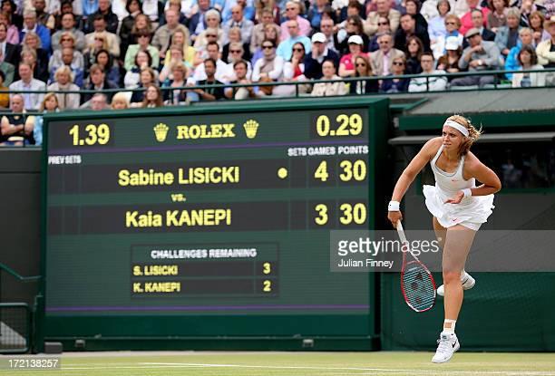 Sabine Lisicki of Germany serves during the Ladies' Singles quarterfinal match against Kaia Kanepi of Estonia on day eight of the Wimbledon Lawn...