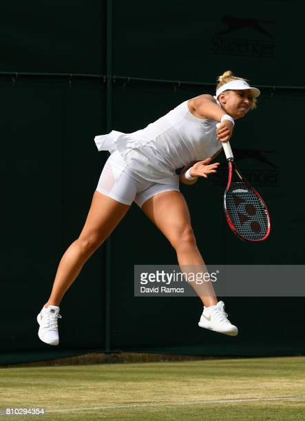 Sabine Lisicki of Germany serves during the Mixed Doubles first round match against Scott Lipsky of the United States and Alla Kudryavtseva of Russia...