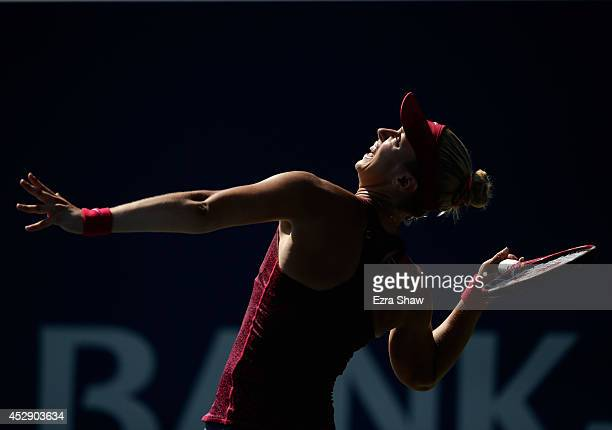 Sabine Lisicki of Germany serves to Ana Ivanovic of Serbia during Day 2 of the Bank of the West Classic at the Taube Family Tennis Stadium on July 29...