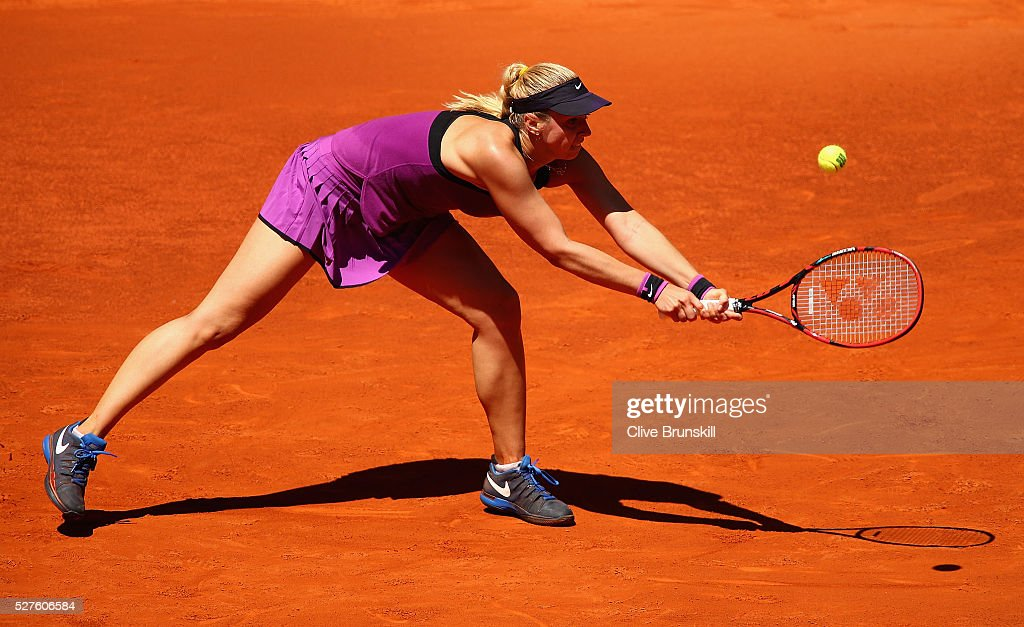 <a gi-track='captionPersonalityLinkClicked' href=/galleries/search?phrase=Sabine+Lisicki&family=editorial&specificpeople=645395 ng-click='$event.stopPropagation()'>Sabine Lisicki</a> of Germany stretches to play a backhand against Carla Suarez Navarro of Spain in their second round match during day four of the Mutua Madrid Open tennis tournament at the Caja Magica on May 03, 2016 in Madrid,Spain.