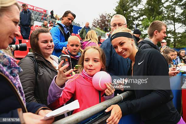 Sabine Lisicki of Germany takes selfies with fans after defeating Laura Arruabarrena of Spain during day four of the Nuernberger Versicherungscup...