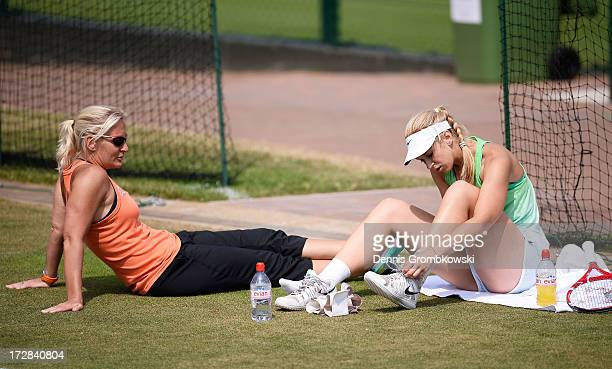 Sabine Lisicki of Germany talks with Barbara Rittner captain of the German Fed Cup team during a practice session on day eleven of the Wimbledon Lawn...