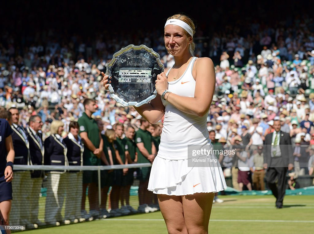 Sabine Lisicki poses with the runner-up trophy after being beaten by Marion Bartoli in the Ladies Singles Final on Day 12 of the Wimbledon Lawn Tennis Championships at the All England Lawn Tennis and Croquet Club on July 6, 2013 in London, England.