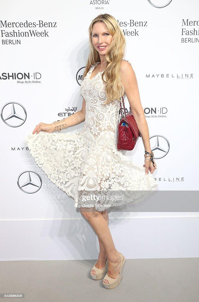Sabine Piller, wearing a white dress by Lena Hoschek during the Lena Hoschek show during the Mercedes-Benz Fashion Week Berlin Spring/Summer 2017 at Erika Hess Eisstadion on June 30, 2016 in Berlin, Germany.