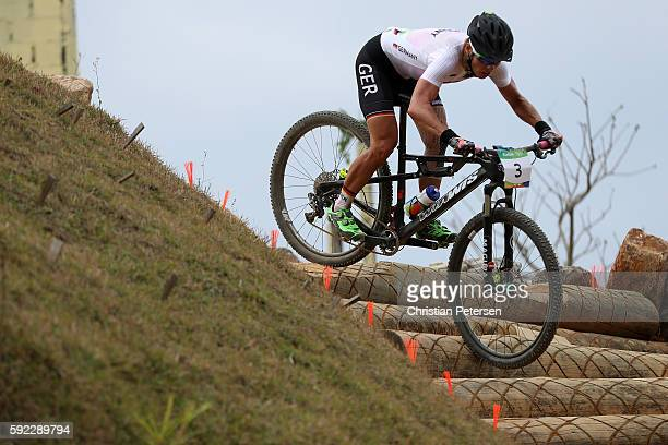 Sabine Spitz of Germany races during the Women's CrossCountry Mountain Bike Race on Day 15 of the Rio 2016 Olympic Games at the Mountain Bike Centre...