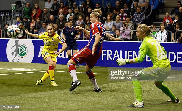 Sabine Stoller of Hoffenheim is challenged by Caro Abbe and Katja Schroffenegger of Muenchen during the DFB Women's Indoor Football Cup 2015 match...