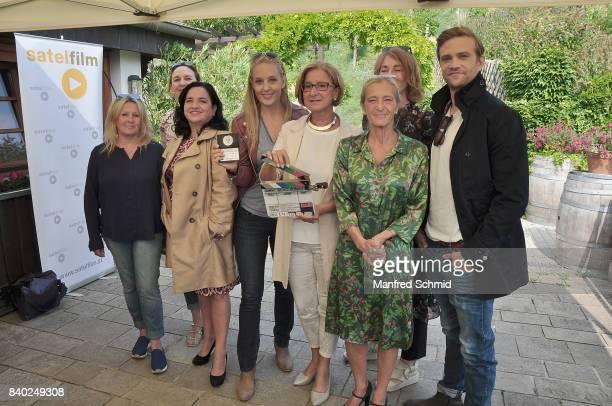 Sabine Weber Maria Happel Lilian Klebow Johanna MiklLeitner Kathrin Zechner and Michael Steinocher pose during a 'Soko Wien' photo call at Heuriger...