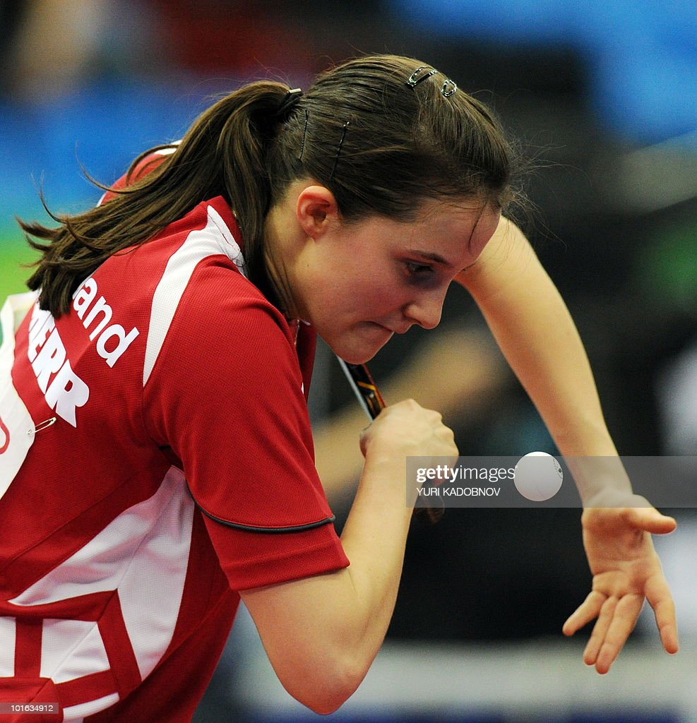 Sabine Winter of Germany serves to Beibei Sun of Singapore during the women's semi final at the 2010 World Team Table Tennis Championships in Moscow on May 29, 2010.