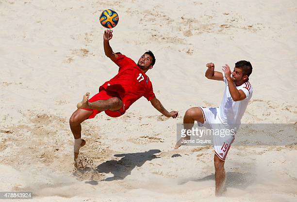Sabir Allahguliyev of Azerbaijan takes a shot at goal under pressure from Norbert Sebestyen of Hungary during day sixteen of the Baku 2015 European...