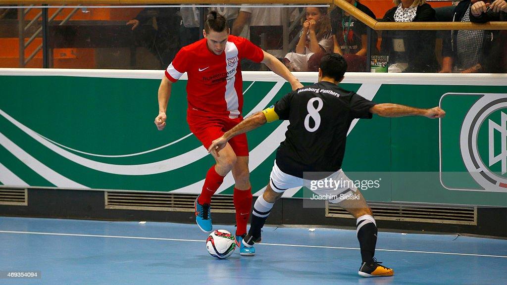 Saboor Khalili of Hamburg challenges Marc Nebgen of Schwerte during the DFB Futsal Cup Final between Holzpfosten Schwerte and Hamburg Panthers at...