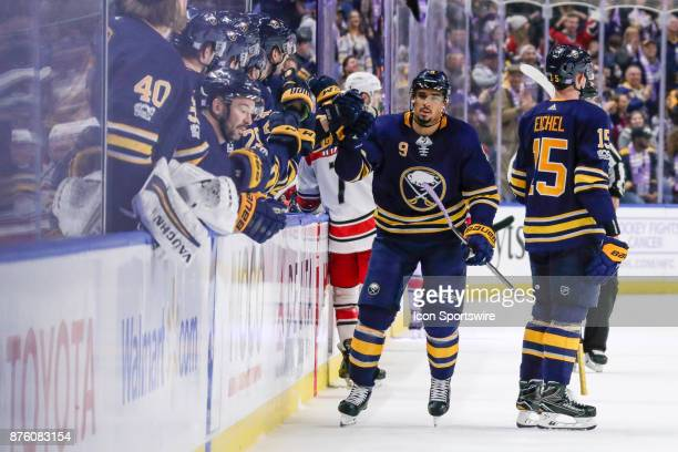 Sabres players congratulate Buffalo Sabres Left Wing Evander Kane after he scores goal during the Carolina Hurricanes and Buffalo Sabres NHL game on...