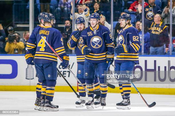 Sabres teammates congratulate Buffalo Sabres Defenseman Rasmus Ristolainen on his goal during the Montreal Canadiens and Buffalo Sabres NHL game on...