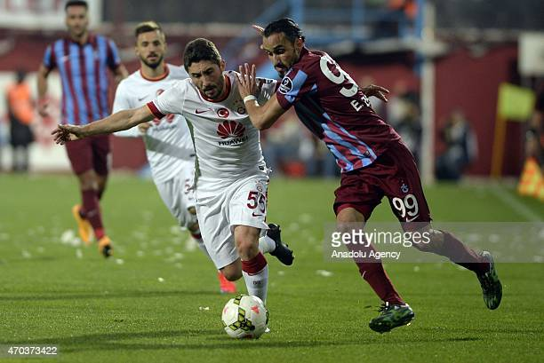Sabri Sarioglu of Galatasaray in action against Erkan Zengin of Trabzonspor during the Turkish Spor Toto Super League soccer match between...
