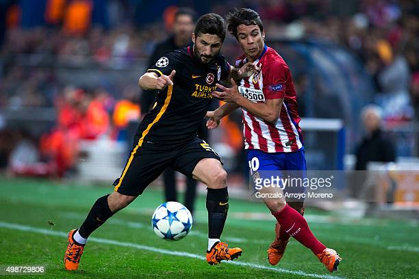 Sabri Sariouglu of Galatasaray AS competes for the ball with Oliver Torres of Atletico de Madrid during the UEFA Champions League Group C match...