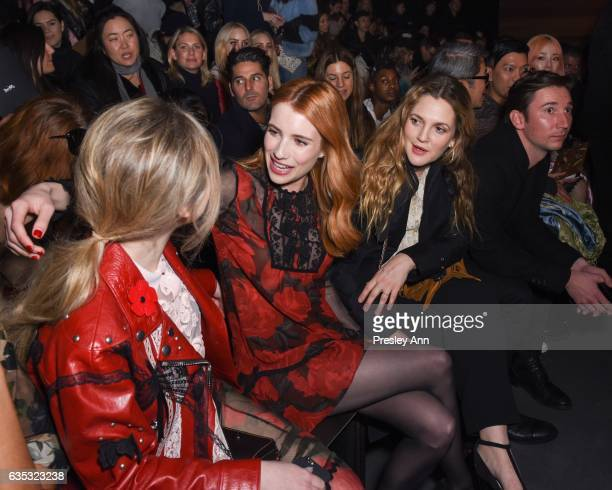 Sabrina Carpenter Emma Roberts and Drew Barrymore sit front row the Coach FW17 Show during Fashion Week at Pier 76 on February 14 2017 in New York...