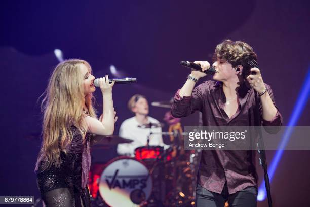 Sabrina Carpenter joins Bradley Simpson of The Vamps on stage at Manchester Arena on May 6 2017 in Manchester England