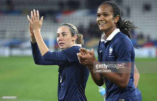 Sabrina Delannoy and Wendie Renard of France thank the fans after the women's international friendly match between France and The Netherlands at...