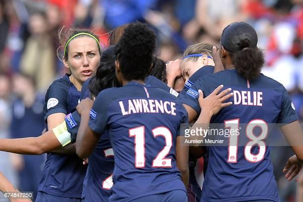Sabrina Delannoy of Paris SaintGermain congratulates teammates after a goal during the Women's Champions League match between Paris Saint Germain and...