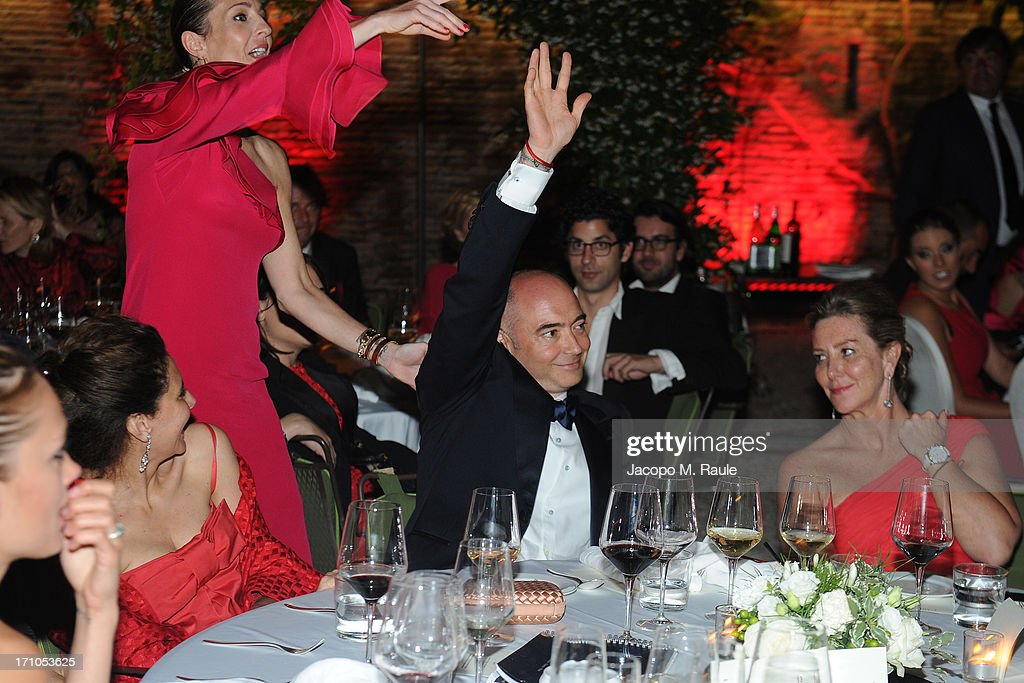 Sabrina Dunn, Julie Brangstrup, Richard Dunn and Katy Barker attend Cash & Rocket On Tour Women for Women - Gala Dinner and Auction on June 16, 2013 in Rome, Italy.