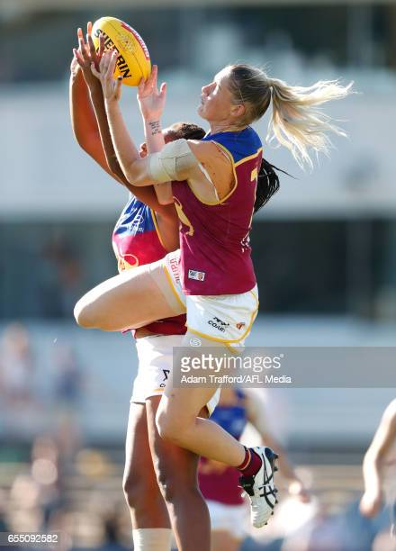 Sabrina FrederickTraub and Tayla Harris of the Lions compete for the ball during the 2017 AFLW Round 07 match between the Carlton Blues and the...
