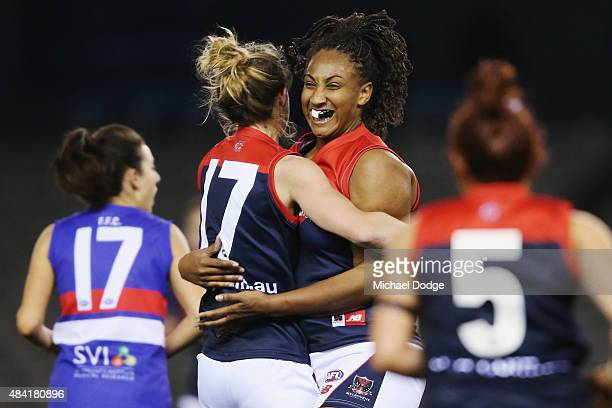 Sabrina FrederickTraub of the Demons celebrates a goal with Emma Swanson during a Women's AFL exhibition match between Western Bulldogs and Melbourne...