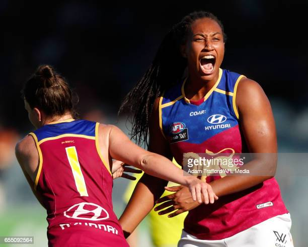 Sabrina FrederickTraub of the Lions celebrates a goal with Emily Bates of the Lions during the 2017 AFLW Round 07 match between the Carlton Blues and...