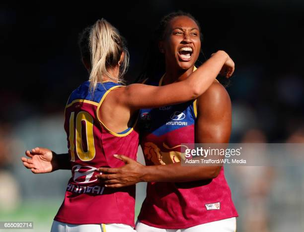 Sabrina FrederickTraub of the Lions celebrates a goal with Kaitlyn Ashmore of the Lions during the 2017 AFLW Round 07 match between the Carlton Blues...