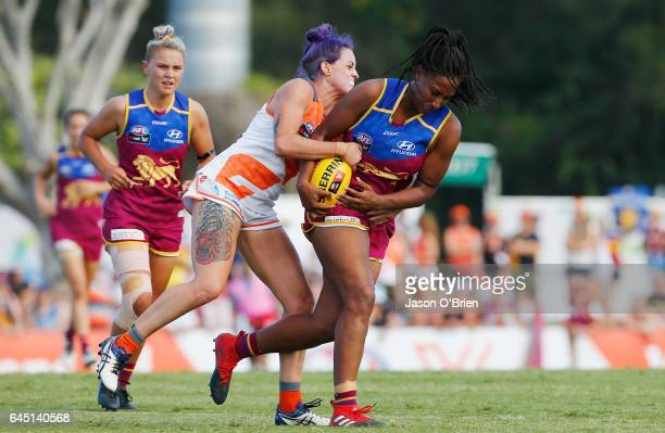Sabrina FrederickTraub of the Lions is tackled by Kristy De Pellegrini of the Giants during the round four Women's AFL match between the Brisbane...
