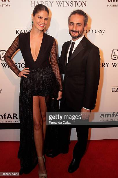 Sabrina Gasparin and Ara Vartanian attends the 5th Annual amfAR Inspiration Gala at the home of Dinho Diniz on April 10 2015 in Sao Paulo Brazil