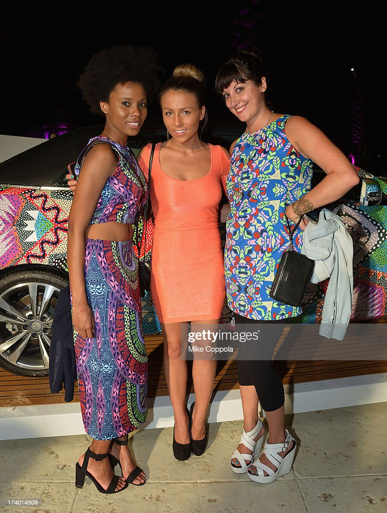 Sabrina George, Gina Gorman, and Emily Bungert pose for a picture at Mercedes-Benz Fashion Week Swim 2014 Official Coverage - Day 1 at Raleigh Hotel on July 18, 2013 in Miami Beach, Florida.