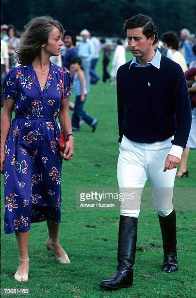 Sabrina Guiness and Prince Charles Prince of Wales arrive for a polo match at Windsor Great Park during August 1979 in Windsor England Ms Guinness...