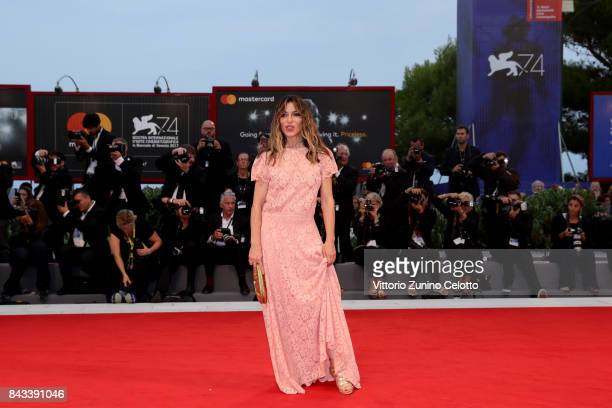 Sabrina Impacciatore walks the red carpet ahead of the 'Ammore E Malavita' screening during the 74th Venice Film Festival at Sala Grande on September...