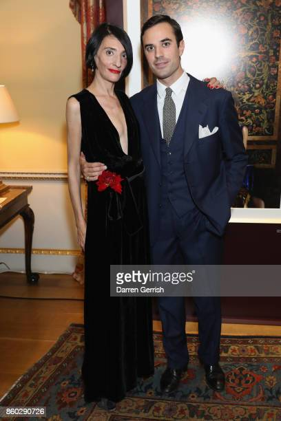 Sabrina Querci and Guido Taroni attend Giampiero Bodino's 'Beauty Is My Favourite Colour' cocktails and dinner evening at Spencer House on October 11...