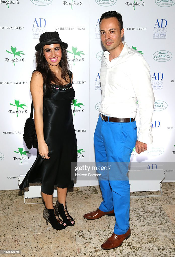 Sabrina Smith and artist Tony Curry attend AD Oasis And Amy Sacco Host Bungalow 8 Party at James Royal Palm Hotel on December 5, 2013 in Miami Beach, Florida.