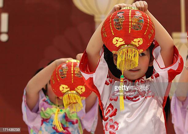 Sabrina So performs the Lantern Dance as Young Folk dancers perform as people start to ring in the Chinese New Year at Scarborough Town Centre the...