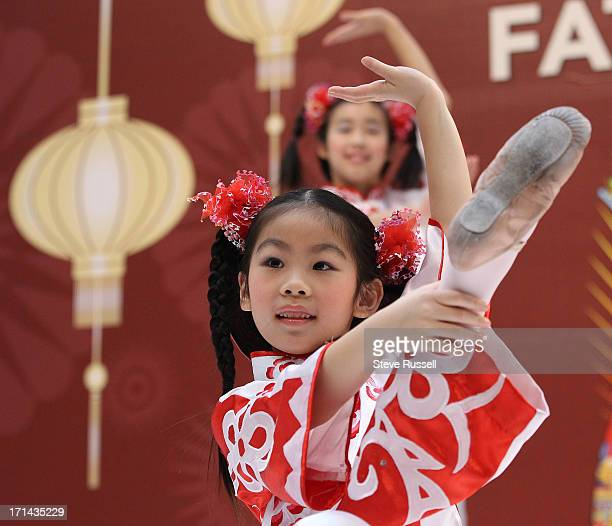 Sabrina So performs the Paper Cutting Dance as Young Folk dancers perform as people start to ring in the Chinese New Year at Scarborough Town Centre...