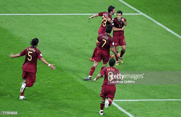 Sabrosa Simao of Portugal is congratulated by team mates after scoring the second goal of the game from the penalty spot during the FIFA World Cup...
