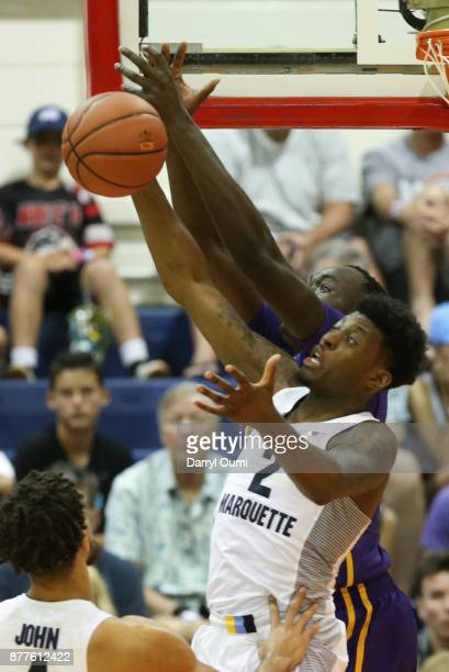 Sacar Anim of the Marquette Golden Eagles and Brandon Sampson of the LSU Tigers joust for a rebound during the first half of their game at the Maui...