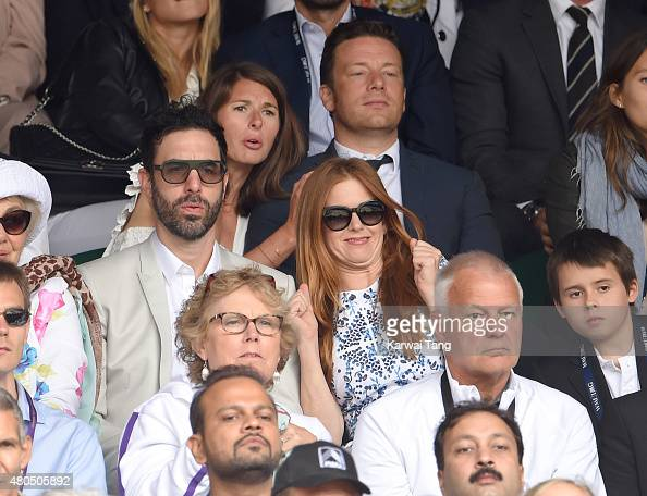 Sacha Baron Cohen Jools Oliver Jamie Oliver and Isla Fisher attend day 13 of the Wimbledon Tennis Championships at Wimbledon on July 12 2015 in...