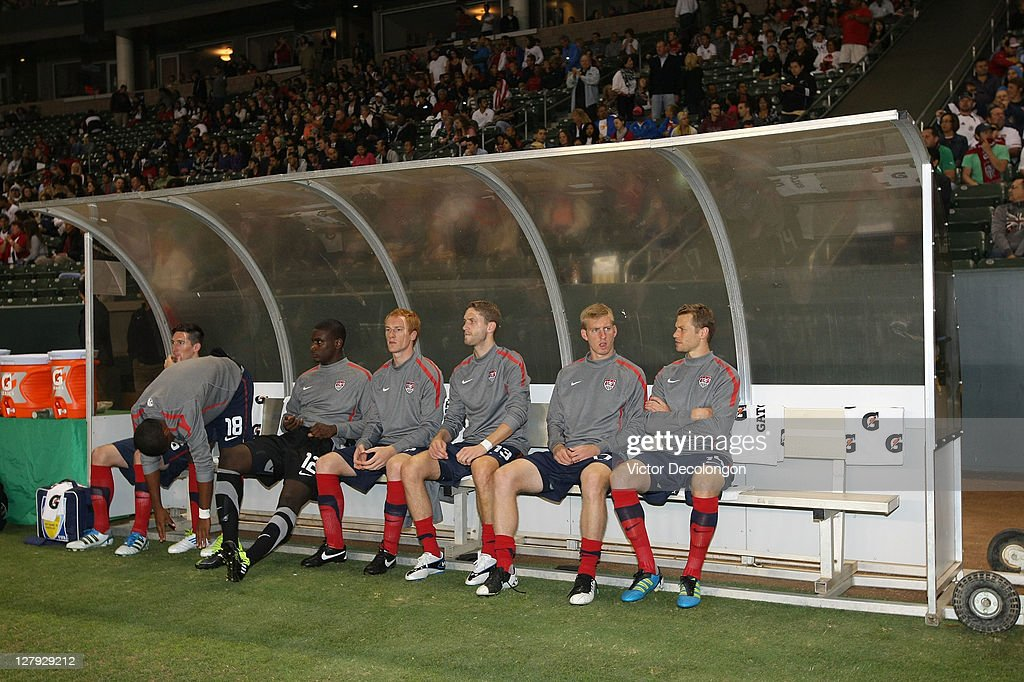 Sacha Kljestan Bill Hamid Jeff Larentowicz Clarence Goodson Tim Ream and Jonathan Spector of the USA look on from the bench as teammate Juan Agudelo...