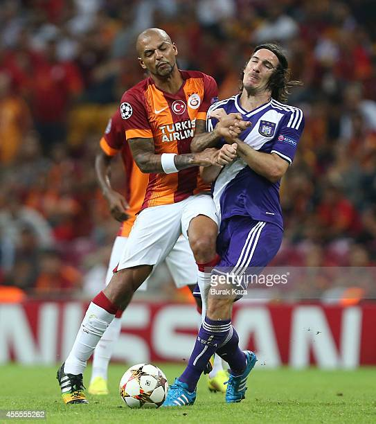 Sacha Kljestan of Anderlecht is tackled by Galatasaray's Felipe Melo during their UEFA Champions Leauge group D match on September 16 at TT Arena...