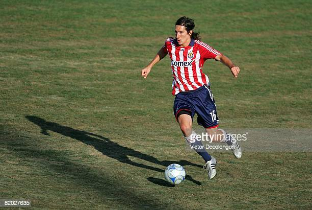 Sacha Kljestan of CD Chivas USA dribbles through midfield on the attack in the second half during their SuperLiga match against the New England...