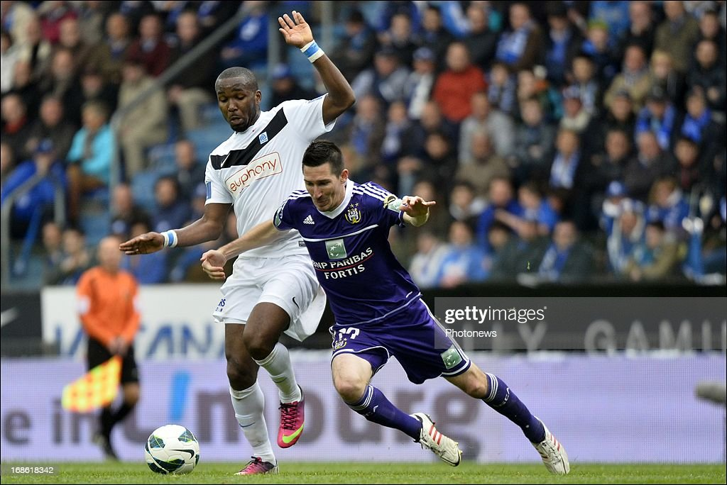 Sacha Kljestan of RSC Anderlecht battles for the ball with Khaleem Hyland of KRC Genk during the Jupiler League play-off 1 match between KRC Genk and RSC Anderlecht on May 12, 2013 in the Cristal Arena in Genk, Belgium.