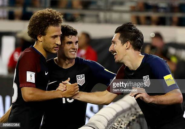 Sacha Kljestan of the United States is congratulated by Christian Pulisic and Fabian Johnson following a goal during the FIFA 2018 World Cup...