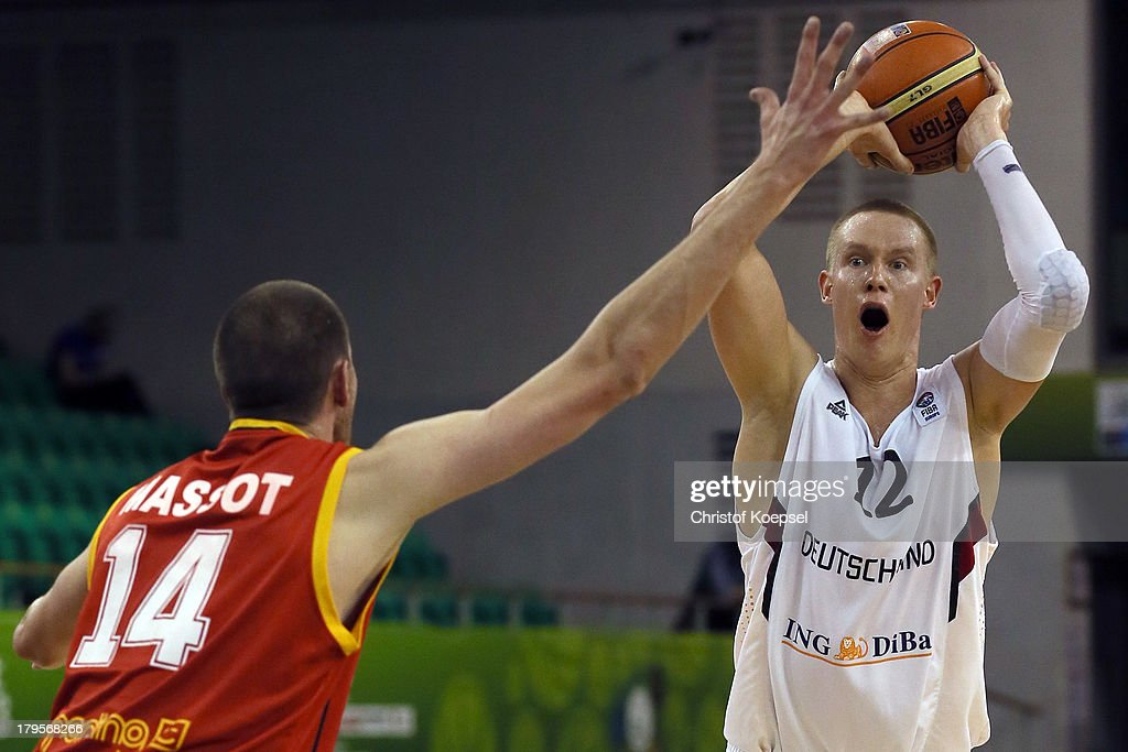 Sacha Massot of Belgium defends against Robin Benzing of Gemany during the FIBA European Championships 2013 first round group A match between Germany and Belgium at Tivoli Arena on September 5, 2013 in Ljubljana, Slovenia.