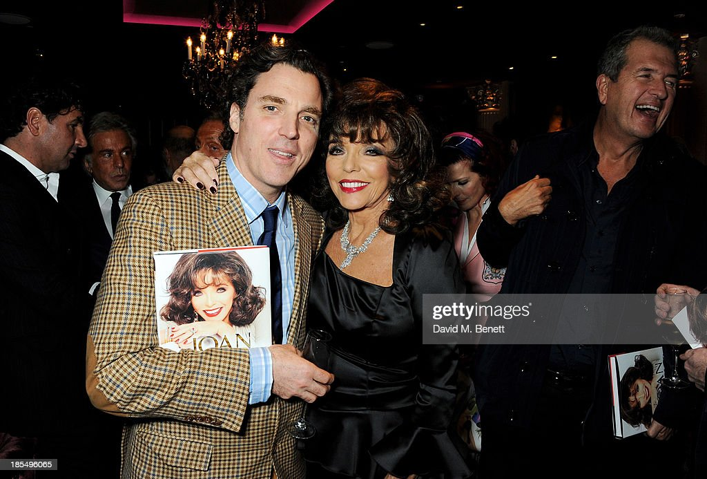Sacha Newley (L) and Joan Collins attend the launch of Joan Collins new book 'Passion For Life' at No.41 Mayfair Club at The Westbury Hotel on October 21, 2013 in London, England.