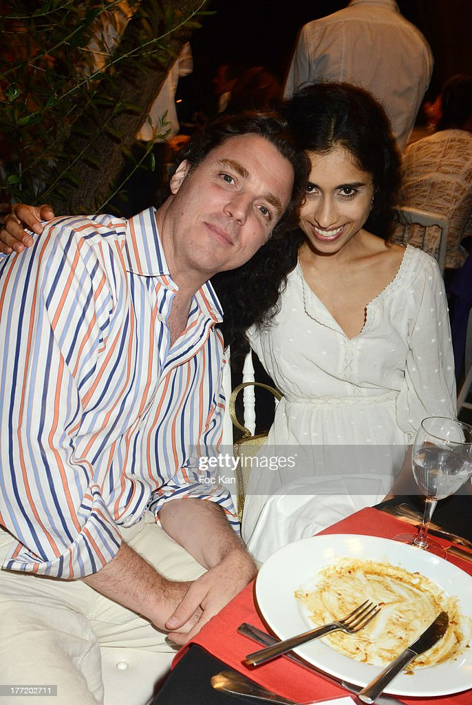 Sacha Newley (son of Joan Collins) and Sheela Raman attend the Massimo Gargia's Birthday Dinner at Moulins de Ramatuelle on August 21, 2013 in Saint Tropez, France.